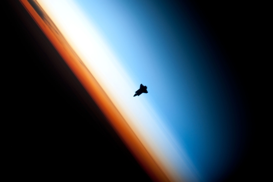 35. Orbital Sunset: Beautiful View of Earth's Colorful Horizon and the Silhouette of Space Shuttle Endeavour (STS-130), February 9, 2010 As Seen From the International Space Station (Expedition 22) While Orbiting Above the South Pacific Ocean Off the Coast of Southern Chile Latitude (LAT): -46.9 · Longitude (LON): -80.5 · Altitude (ALT): 183 Nautical Miles